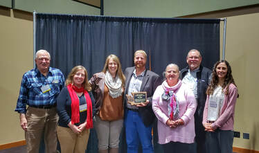 Rich & Ann Appel with the Whatcom Conservation staff, receiving the Vim Wright